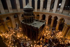 Christian pilgrims hold candles at the Church of the Holy Sepulcher, traditionally believed to be the site of the crucifixion of Jesus Christ, during the ceremony of the Holy Fire in Jerusalem's Old City, Saturday, April 26, 2008. The Holy Fire ceremony is part of Orthodox Easter rituals and the flame symbolizes the resurrection of Christ. The ceremony dates back to the 12th century. (AP Photo/Sebastian Scheiner)
